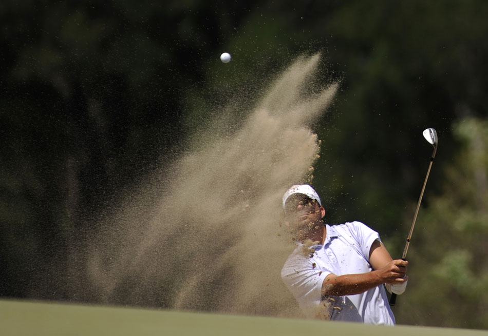 Matt Wernecke blasts out of the sand on the 18th hole during the final round of the Austin City Golf Championship at Jimmy Clay Golf Course on Sunday, Aug. 8, 2010. Wernecke was able to save par on the hole, securing a one-stroke victory over Brenden Redfern.