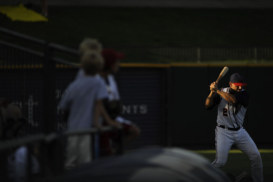 Youngsters watch as Express catcher Brian Esposito (2) warms up in a slit of light in the outfield before a game against Sacramento at Dell Diamond on Tuesday, Aug. 10, 2010.