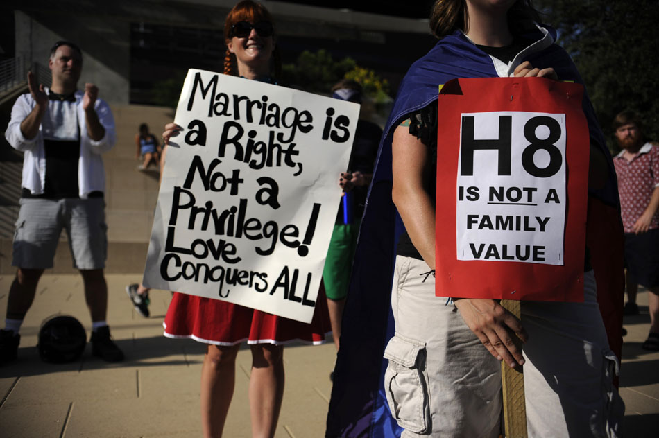 Gay rights activists hold signs at a rally for gay marriage rights at Austin City Hall on Wednesday, Aug. 4, 2010.