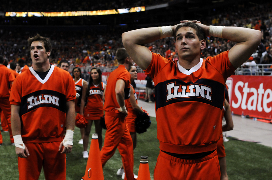 Illinois cheerleaders watch a video replay in disbelief after quarterback Nathan Scheelhaase threw an interception in a game against Missouri on Saturday, Sept. 4, 2010, at the Edward Jones Dome in St. Louis.