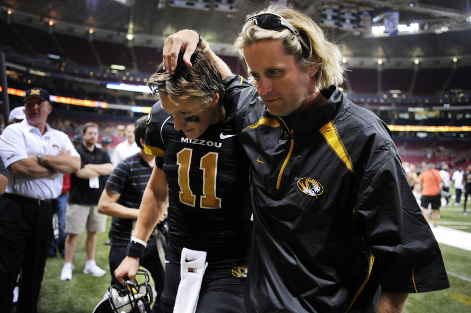 Missouri quarterback Blaine Gabbert gets some encouragement from offensive coordinator David Yost following the team's 23-13 win against Illinois on Saturday, Sept. 4, 2010, at the Edward Jones Dome in St. Louis.