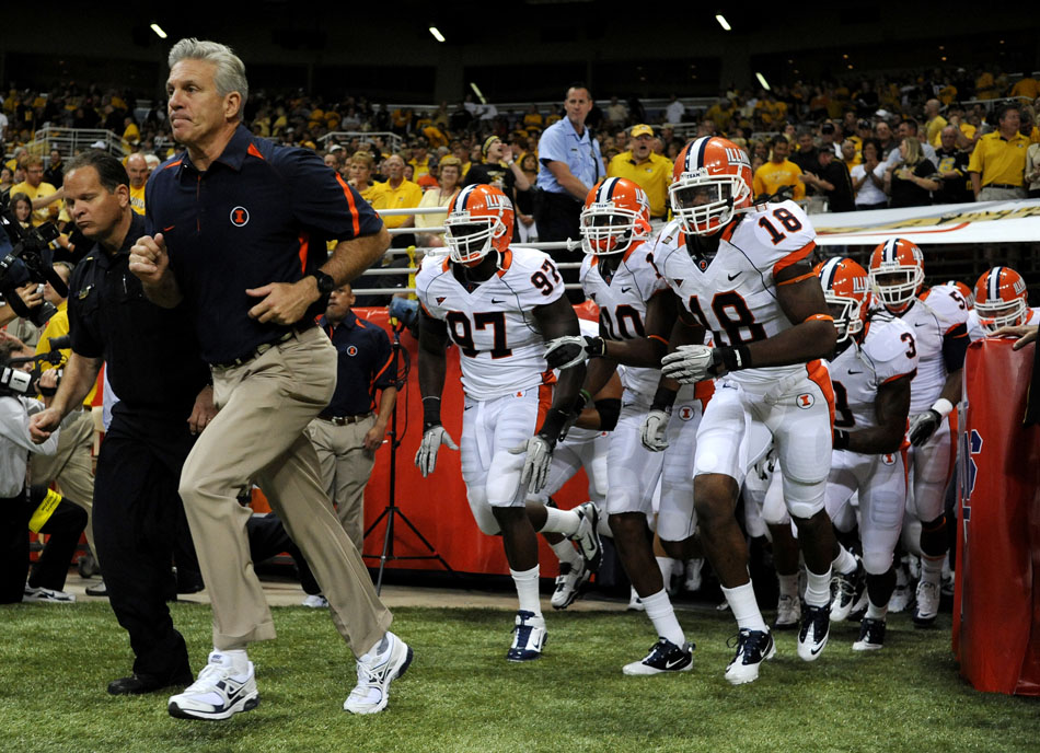 Illinois coach Ron Zook leads his team onto the field to take on Missouri in the Arch Rivarly on Saturday, Sept. 4, 2010, at the Edward Jones Dome in St. Louis.