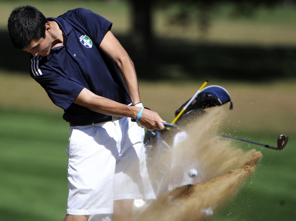 Peoria Notre Dame's Stuart Krick blasts out of a bunker on the 11th hole during the Mid-State 6 conference tournament on Thursday, Sept. 30, 2010, at Kellogg Golf Course.