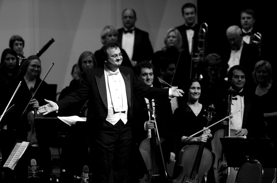"""George Stelluto, music director of the Peoria Symphony Orchestra, reacts to the audience's applause after the orchestra's first piece of the evening during a performance on Saturday, Sept. 18, 2010, at the Peoria Civic Center. The orchestra opened with """"Meistersinger Overture"""" by Richard Wagner."""