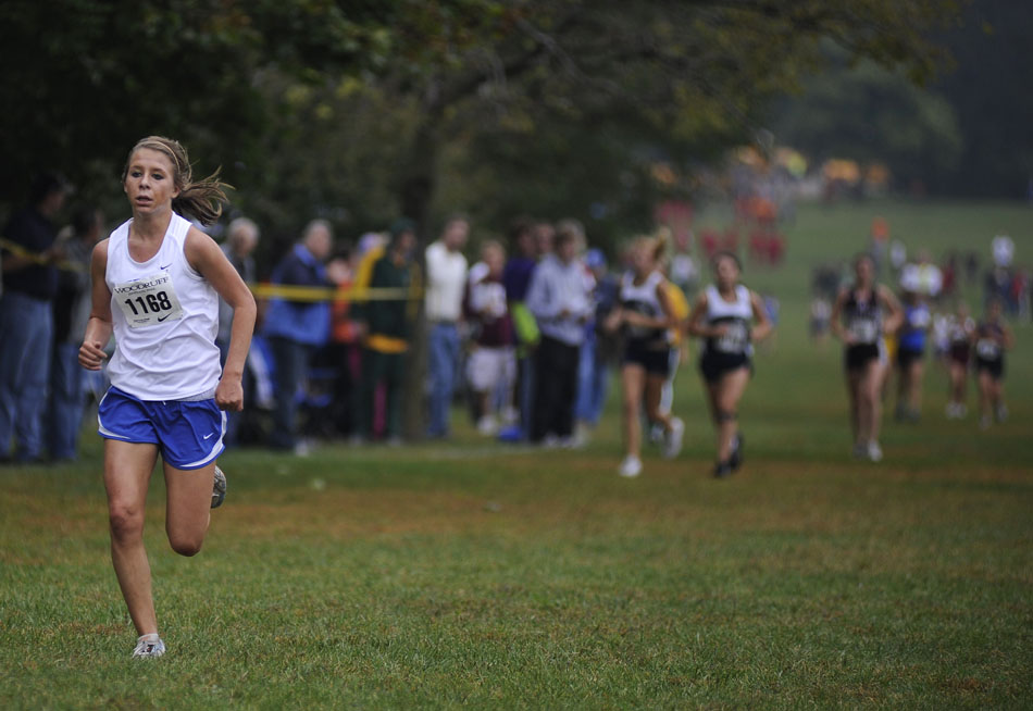 Freeburg's Kristen Busch breaks away from the pack as she runs in a Class 1A race during the Woodruff Cross Country on Saturday, Sept. 11, 2010, in Detweiller Park.