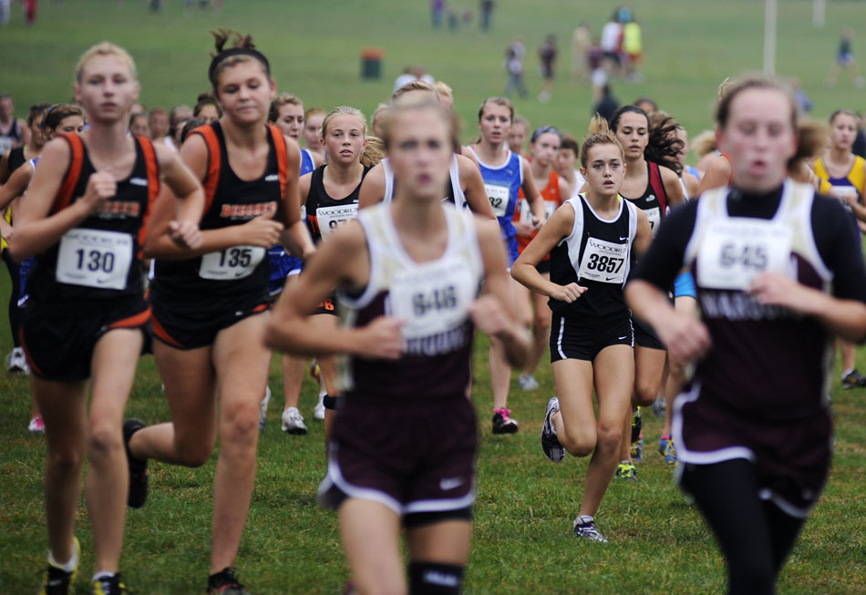 A pack of girls make their way around the course in a Class 1A race during the Woodruff Cross Country on Saturday, Sept. 11, 2010, in Detweiller Park.