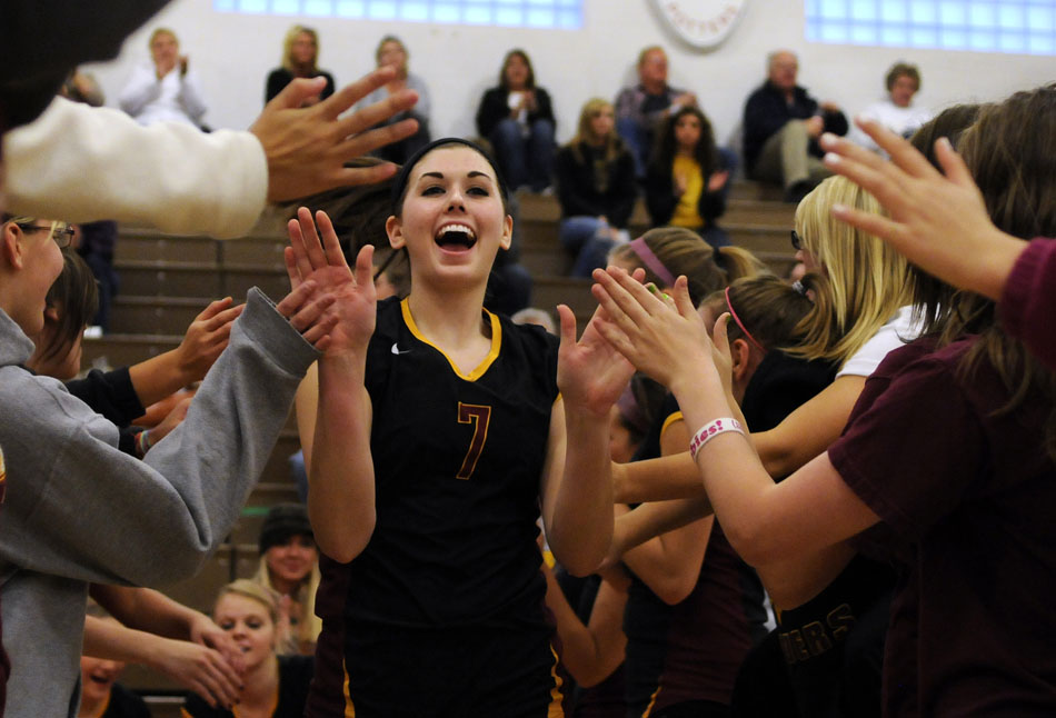 East Peoria's Allison Schartman gets some high fives from fans as she's introduced as a starter during a Class 3A semi-final against Canton on Thursday, Oct. 28, 2010, in Morton.