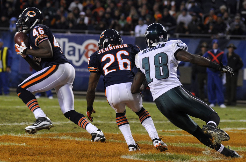 Chicago Bears safety Chris Harris (46) intercepts a pass intended for Philadelphia Eagles wide receiver Jeremy Maclin (18) in the endzone during a game on Sunday, Nov. 28, 2010, at Soldier Field in Chicago.
