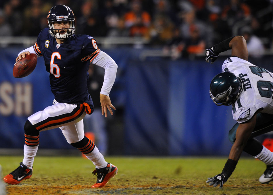 Chicago Bears quarterback Jay Cutler (6) scrambles away from Philadelphia Eagles defensive end Darryl Tapp (91) during a game on Sunday, Nov. 28, 2010, at Soldier Field in Chicago.