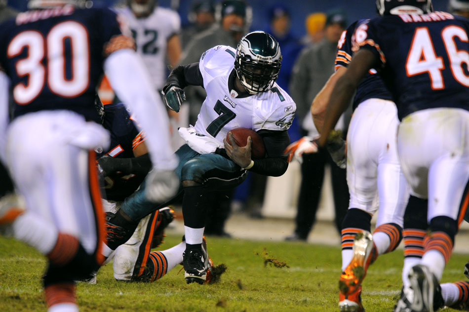 Philadelphia Eagles quarterback Michael Vick (7) avoids a defender on a rushing attempt during a game on Sunday, Nov. 28, 2010, at Soldier Field in Chicago.