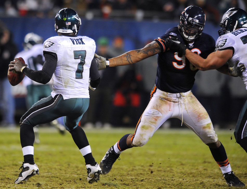 Chicago Bears defensive end Julius Peppers (90) applies pressure to Philadelphia Eagles quarterback Michael Vick (7) during a game on Sunday, Nov. 28, 2010, at Soldier Field in Chicago.