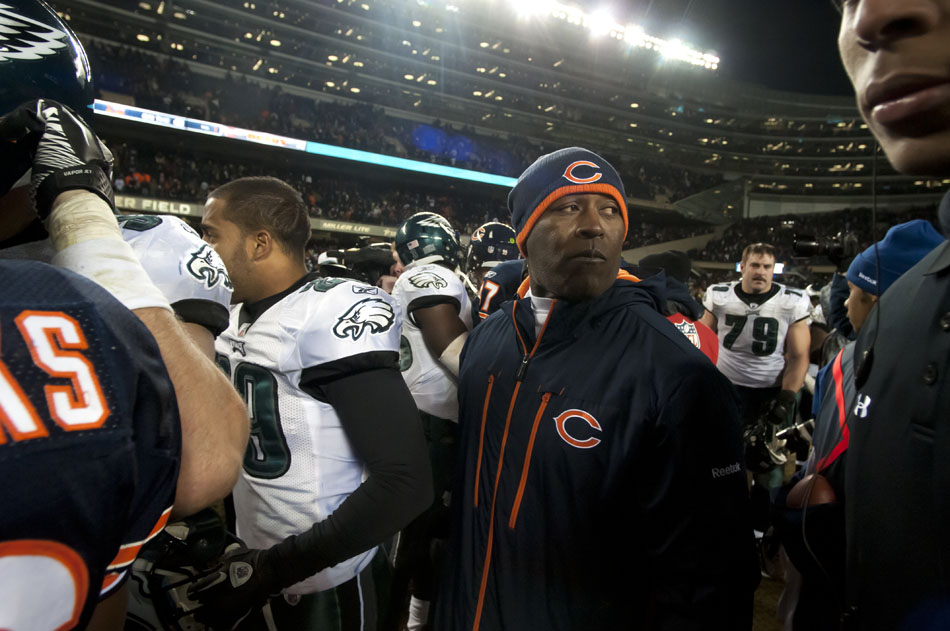 Chicago Bears head coach Lovie Smith works his way through a crowd of players following a 31-26 win over the Philadelphia Eagles on Sunday, Nov. 28, 2010, at Soldier Field in Chicago.