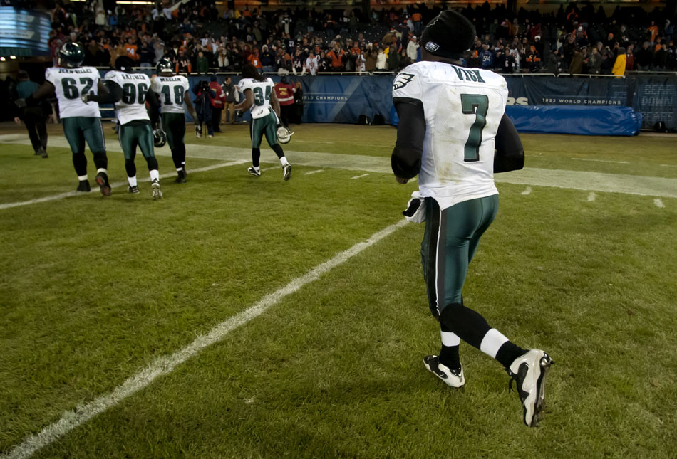 Philadelphia Eagles quarterback Michael Vick (7) jogs off the field following a 31-26 loss to the Chicago Bears on Sunday, Nov. 28, 2010, in Chicago.