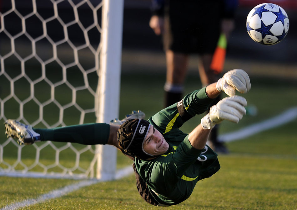 Bradley keeper Brian Billings dives to make a save in penalty kicks overtime in the Missouri Valley Conference championship game against SIU-Edwardsville on Sunday, Nov. 14, 2010, at Shea Stadium.