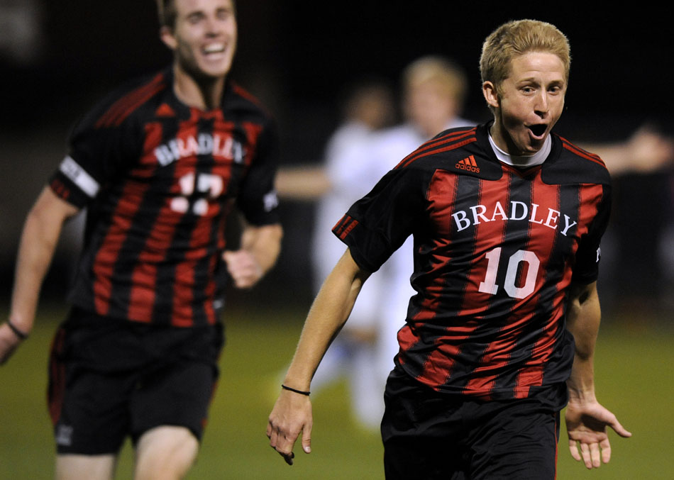 Bradley's Keith Mach celebrates with his teammates after scoring the game-winning goal against Creighton on Friday, Nov. 12, 2010, at Shea Stadium.
