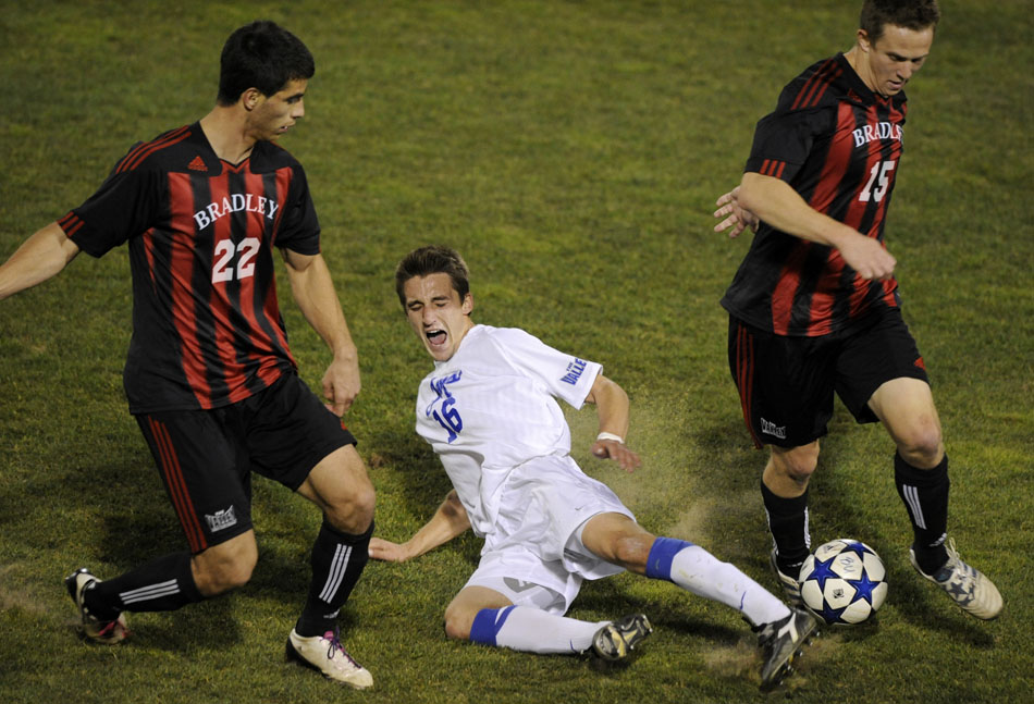 Creighton's Ethan Finlay (16) reacts as he falls to the pitch between Bradley's Christian Meza (22) and Tommy Fritze (15) during a game on Friday, Nov. 12, 2010, at Shea Stadium.