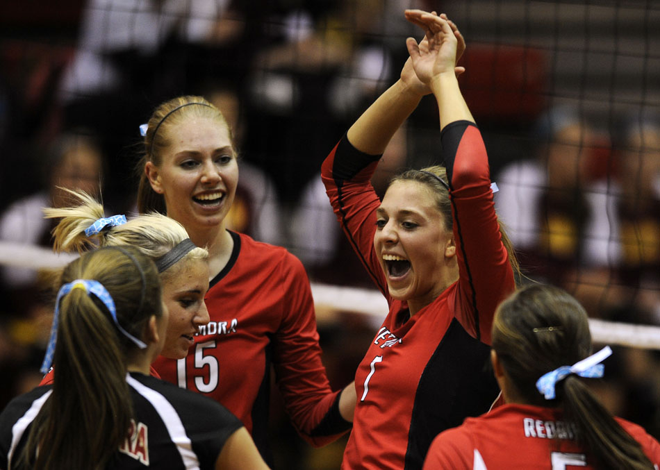 Metamora's Paige Garber, center, celebrates with her teammates during a point in the first set of the sectional championship game against Morris on Thursday, Nov. 4, 2010, in LaSalle, Ill. Metamora won 2-1.