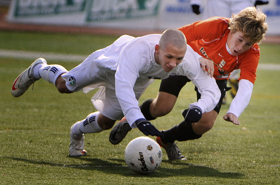 Waterloo's Kellin Daniel, right, throws Peoria Notre Dame's Kevin Whalen to the ground as they play the ball during the Class 2A semi-final on Friday,  Nov. 5, 2010, in Naperville. Notre Dame won 4-0 to advance to Saturday's state championship game.