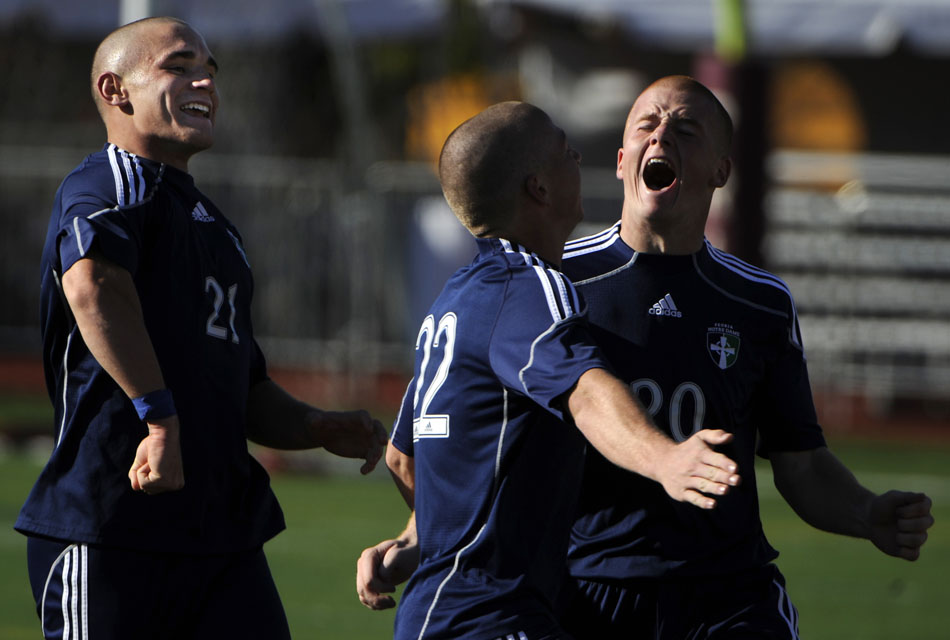 Peoria Notre Dame keeper Mark Streid, right, celebrates after scoring a goal in a 8-0 win against Richwood in the Class 2A state championship game on Saturday, Nov. 6, 2010, in Naperville. Streid was moved from the keeper position after Notre Dame acquired a large lead.