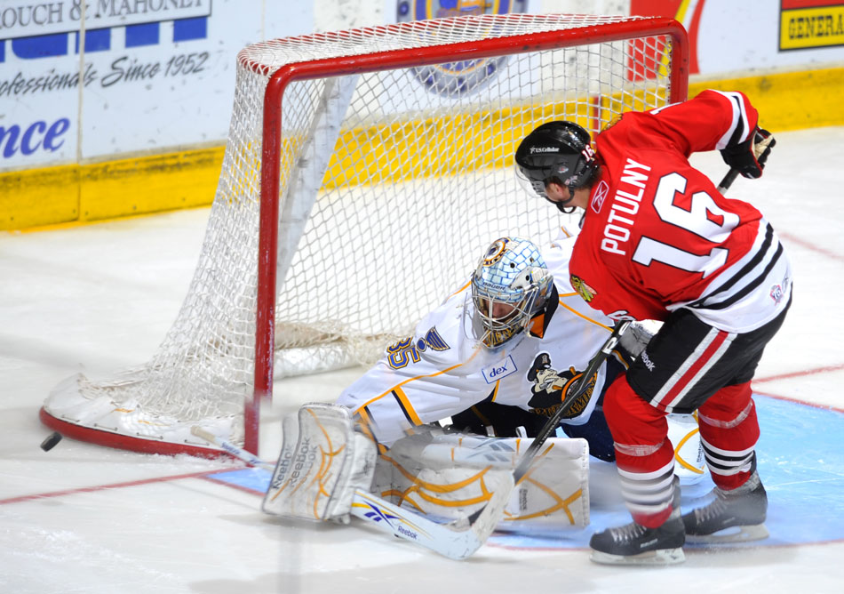 Peoria goalie Jake Allen makes a save as the puck zips wayward of the goal after a shot from Rockford's Ryan Potulny during a shootout in a game on Sunday, Nov. 21, 2010, at Carver Arena.