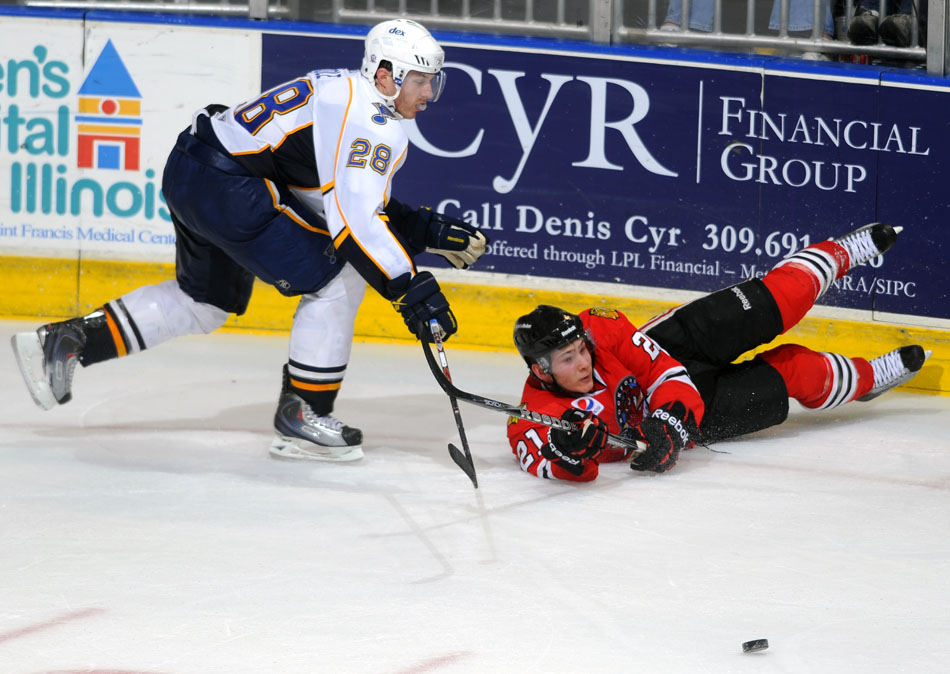 Rockford's Ben Smith (21) knocks the puck away from Peoria's Ian Cole during on Sunday, Nov. 21, 2010, at Carver Arena.