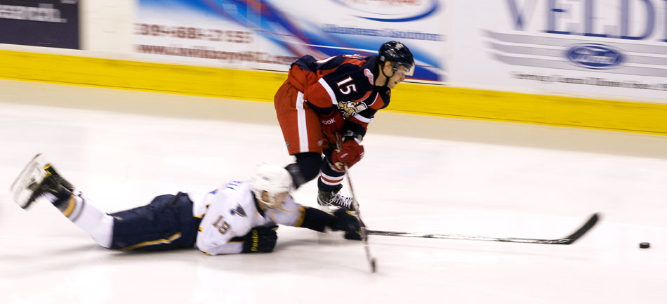 Grand Rapids Griffins forward Ilari Filppula (15) plays the puck as Peoria Rivermen right wing Adam Cracknell (19) slides on the ice during a game on Saturday, Dec. 11, 2010, at Carver Arena.