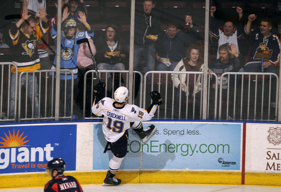 Peoria Rivermen right wing Adam Cracknell celebrates with the crowd after scoring a goal against Grand Rapids on Saturday, Dec. 11, 2010, at Carver Arena.