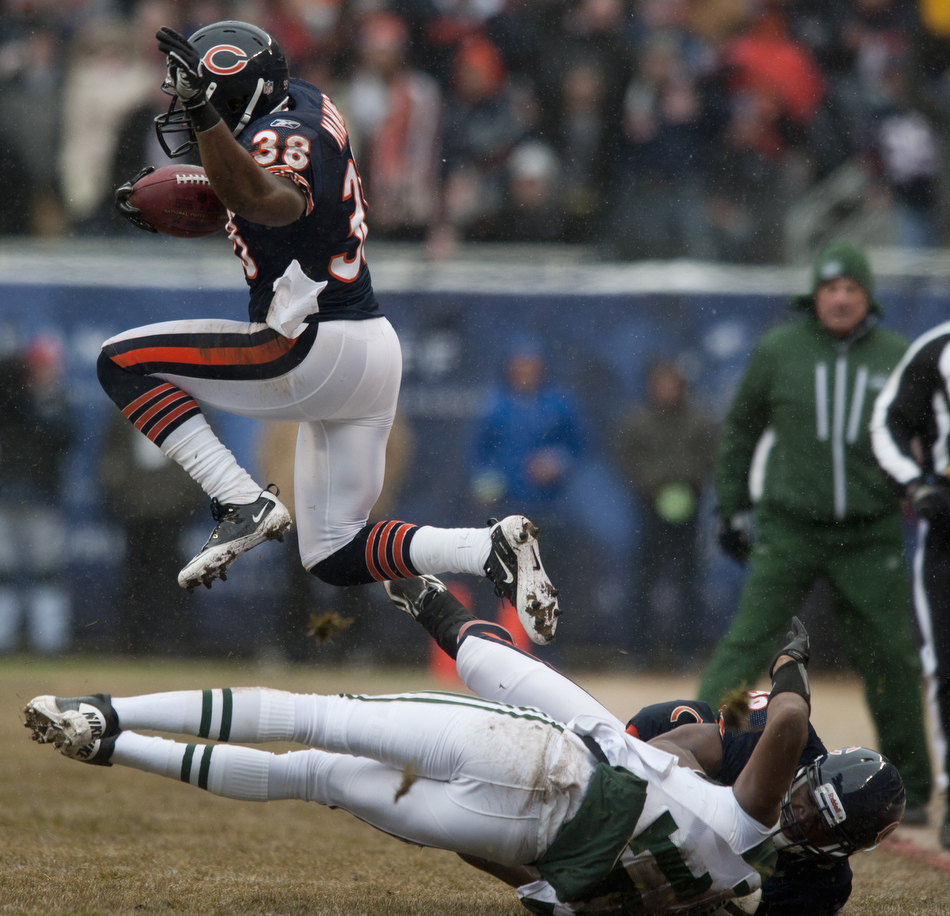 Chicago Bears safety Danieal Manning (38) jumps over a blocker on a kickoff return during the first half of a game on Sunday, Dec. 26, 2010, in Chicago.