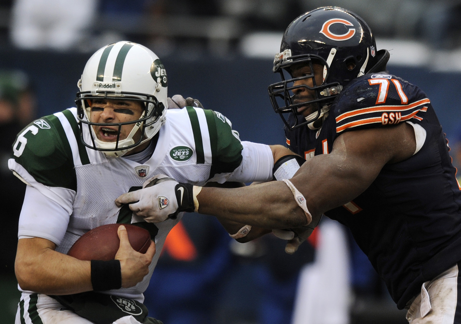 New York Jets quarterback Mark Sanchez (6) reacts as he tries to avoid a sack from Chicago Bears defensive tackle Israel Idonije (71) during the second half of a game on Sunday, Dec. 26, 2010, in Chicago. Chicago won 38-34.