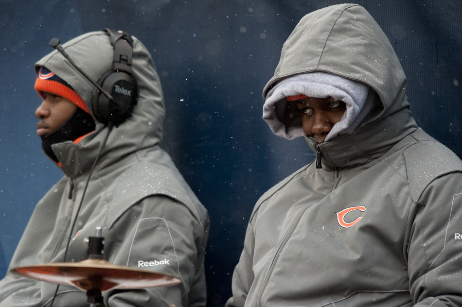 A member of the Chicago Bears drumline tries to stay warm in the cold and snow during the first half of the Bears-Jets game on Sunday, Dec. 26, 2010, in Chicago.