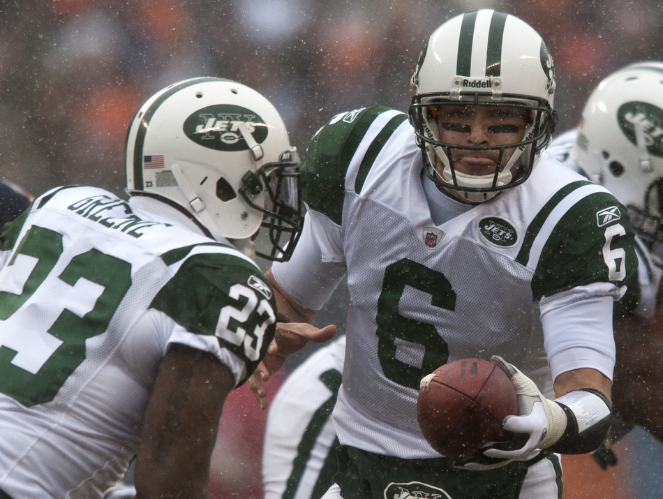 New York Jets quarterback Mark Sanchez (6) hands off to running back Shonn Greene (23) in the snow during the first half of a game on Sunday, Dec. 26, 2010, in Chicago.