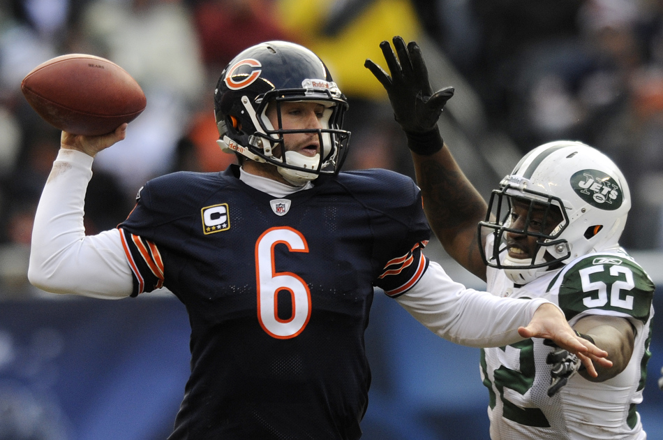 New York Jets linebacker David Harris (52) applies pressure to Chicago Bears quarterback Jay Cutler during a game on Sunday, Dec. 26, 2010, in Chicago. Chicago won 38-34.