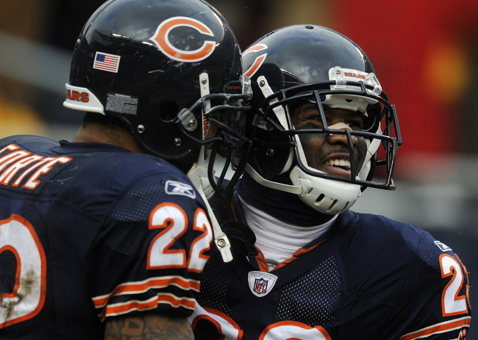 Chicago Bears wide receiver Devin Hester (23) celebrates with teammate Matt Forte after Hester caught a touchdown pass during a game on Sunday, Dec. 26, 2010, in Chicago. Chicago won 38-34.