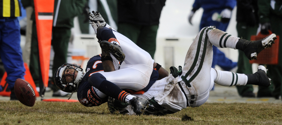 Chicago Bears wide receiver Johnny Knox drops a pass after a hit from New York Jets safety Brodney Pool during a game on Sunday, Dec. 26, 2010, in Chicago. Chicago won 38-34.