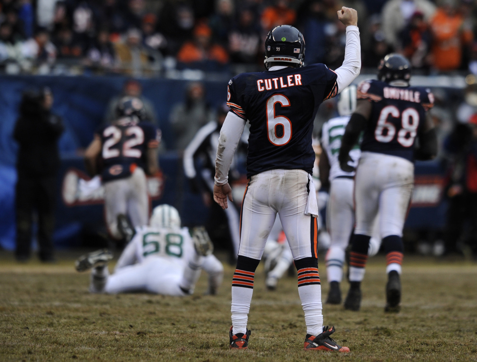 Chicago Bears quarterback Jay Cutler pumps his fist as running back Matt Forte (22) breaks a long run during a game on Sunday, Dec. 26, 2010, in Chicago. Chicago won 38-34.
