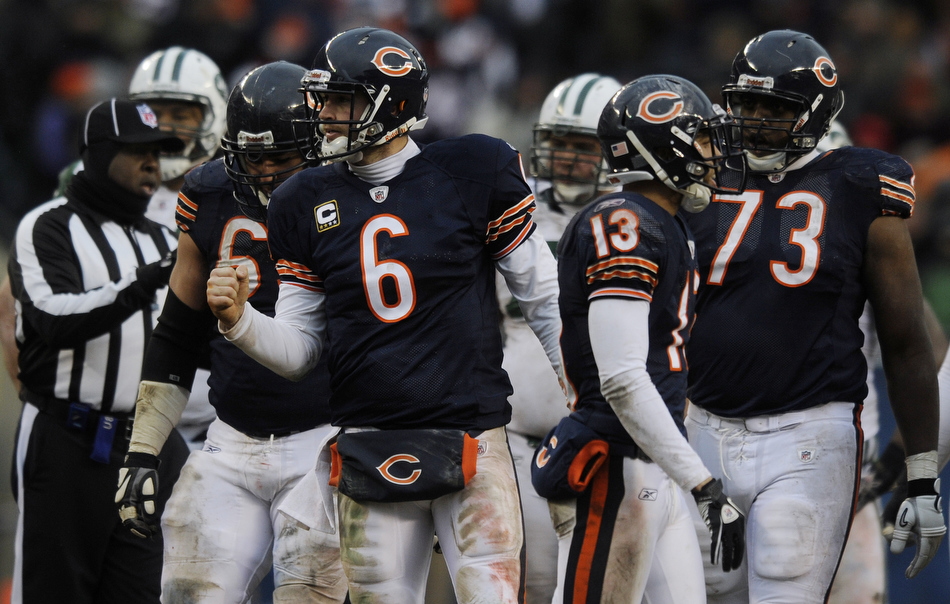 Chicago Bears quarterback Jay Cutler (6) pumps his fist after kneeling on the ball to run out the clock during a 38-34 win over the New York Jets on Sunday, Dec. 26, 2010, in Chicago.