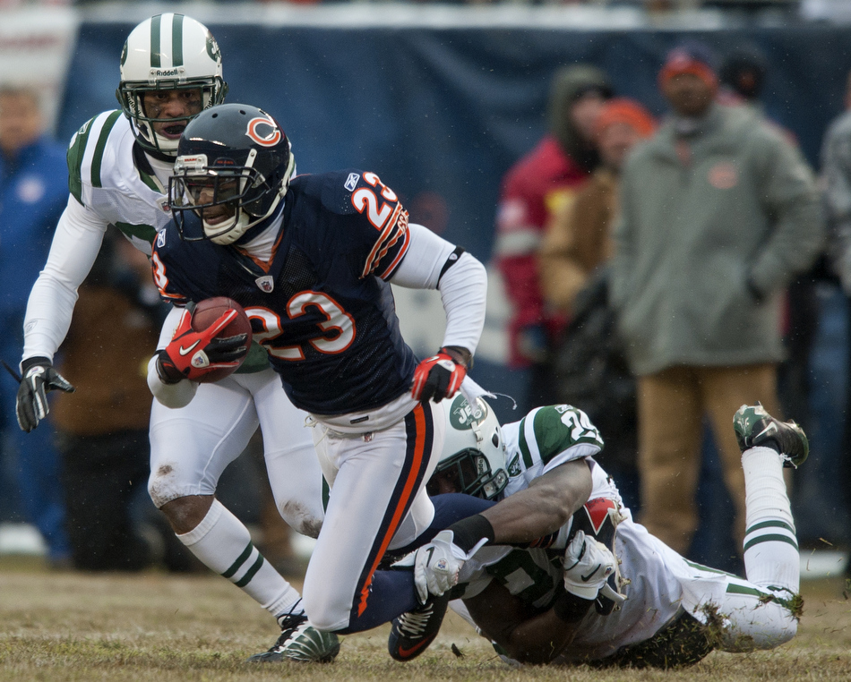 Chicago Bears wide receiver Devin Hester (23) tries to break away from New York Jets cornerback Darrelle Revis, right, and cornerback Dwight Lowery during a game on Sunday, Dec. 26, 2010, in Chicago. Chicago won 38-34.