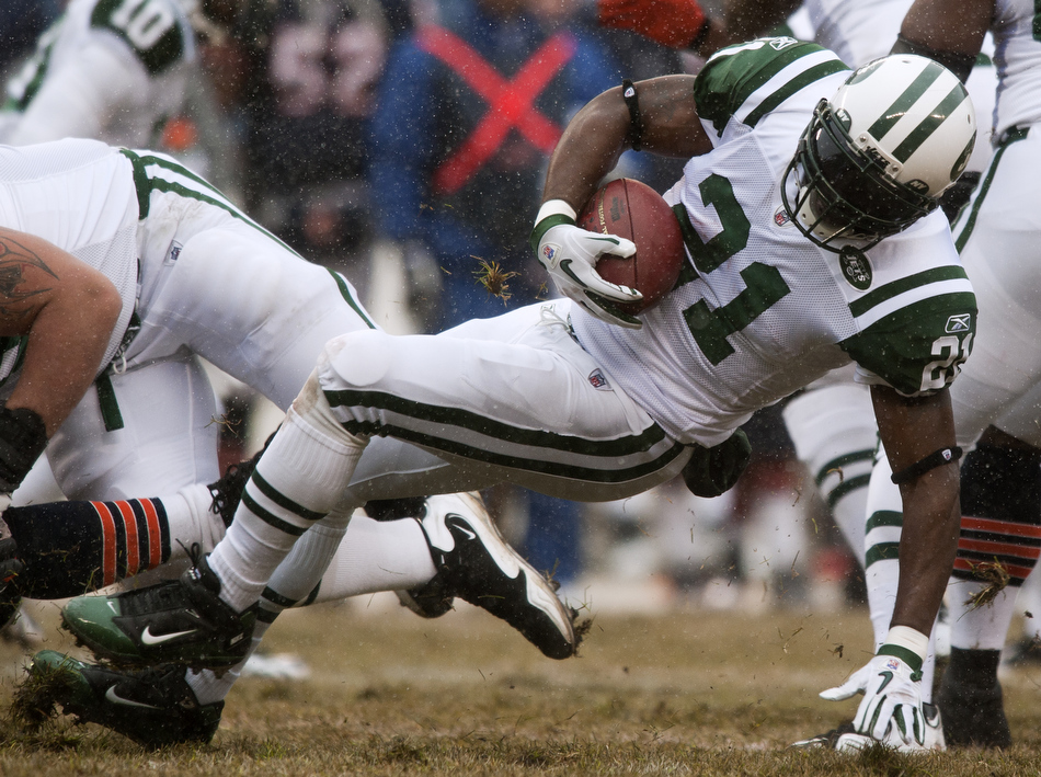 New York Jets running back LaDainian Tomlinson (21) slips and goes down in the backfield as he looks to cut back up field during a game on Sunday, Dec. 26, 2010, in Chicago. Chicago won 38-34.