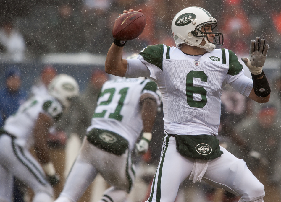 New York Jets quarterback Mark Sanchez (6) looks to pass as snow falls during a game on Sunday, Dec. 26, 2010, in Chicago. Chicago won 38-34.