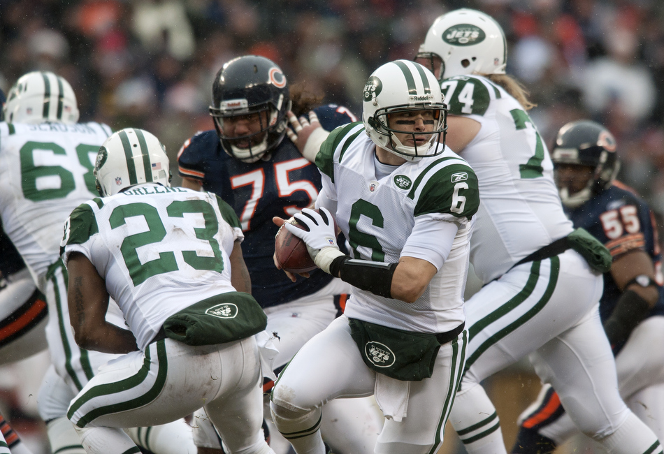 New York Jets quarterback Mark Sanchez (6) rolls out off of a play action fake during a game on Sunday, Dec. 26, 2010, in Chicago. Chicago won 38-34.
