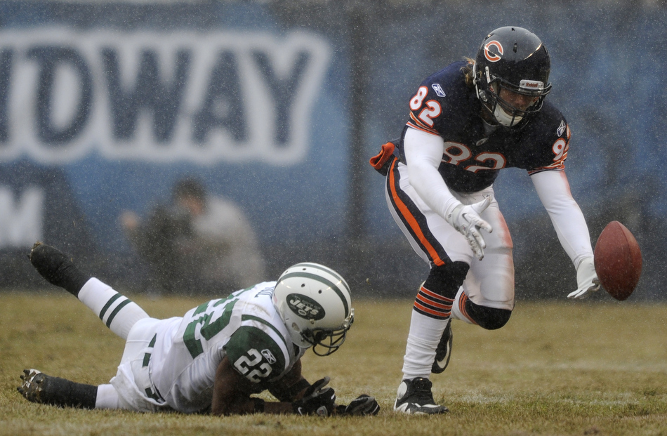 Chicago Bears tight end Greg Olsen (82) tries to make a catch as New York Jets safety Brodney Pool (22) falls to the field during a game on Sunday, Dec. 26, 2010, in Chicago. Chicago won 38-34.