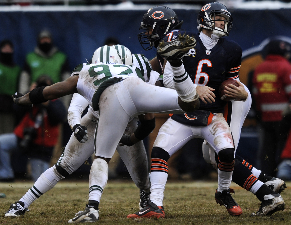 Chicago Bears quarterback Jay Cutler (6) tries to avoid a sack from New York Jets linebacker Calvin Pace (97) during a game on Sunday, Dec. 26, 2010, in Chicago. Chicago won 38-34.