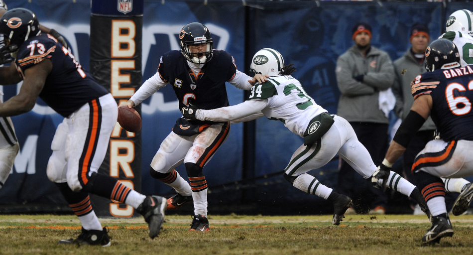 Chicago Bears quarterback Jay Cutler (6) tries to shed off New York Jets cornerback Marquice Cole (34) during a game on Sunday, Dec. 26, 2010, in Chicago. Chicago won 38-34.