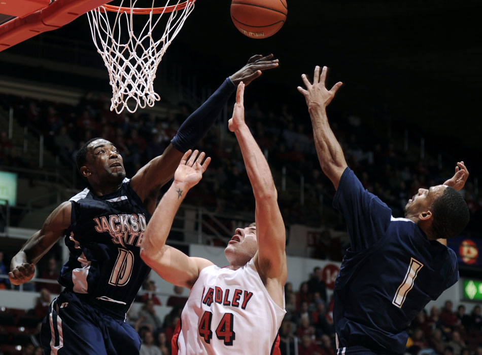 Jackson State's Tyronne Hanson (10) and Cason Burk (1) try to block a shot from Bradley Braves forward Jordan Prosser (44) during a game on Monday, Dec. 20, 2010, at Carver Arena.