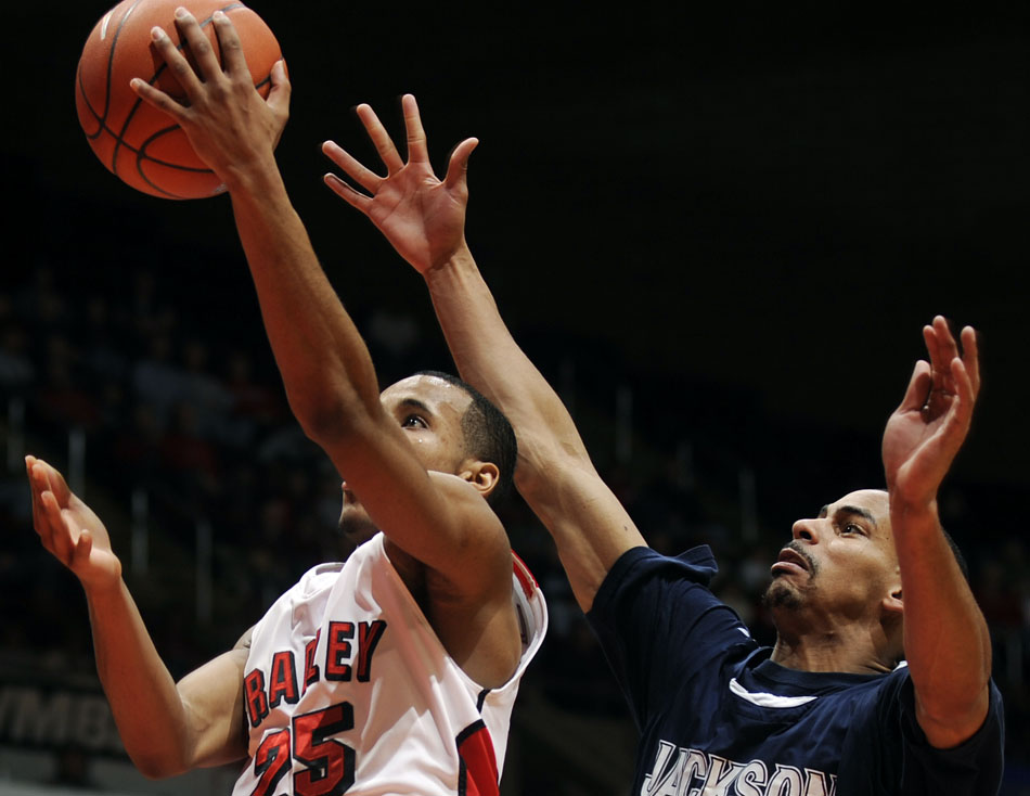 Bradley Braves guard Walt Lemon puts up a shot in front of Jackson State's Cason Burk during a game on Monday, Dec. 20, 2010, at Carver Arena.
