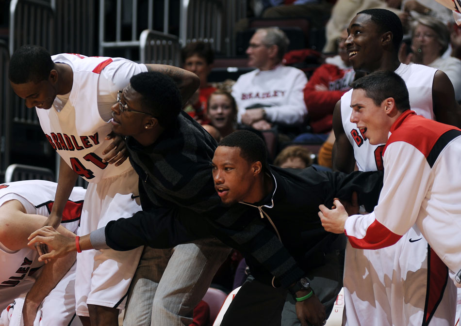 The Bradley bench errupts after Andrew Warren, not pictured, threw down a dunk in the second half of a game against Jackson State on Monday, Dec. 20, 2010, at Carver Arena.