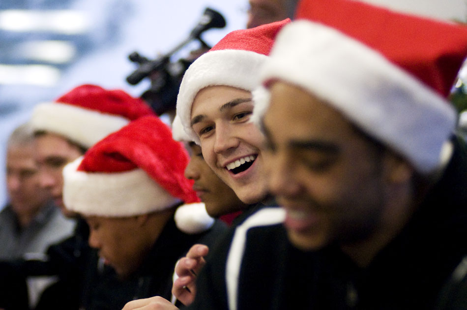 Bradley basketball forward Milos Knezevic shares a laugh with his teammates as they sign autographs during a visit to Methodist Hospital on Thursday, Dec. 16, 2010. The team greeted patients in their rooms and signed autographs for employees and patients at the hospital's Christmas dinner.