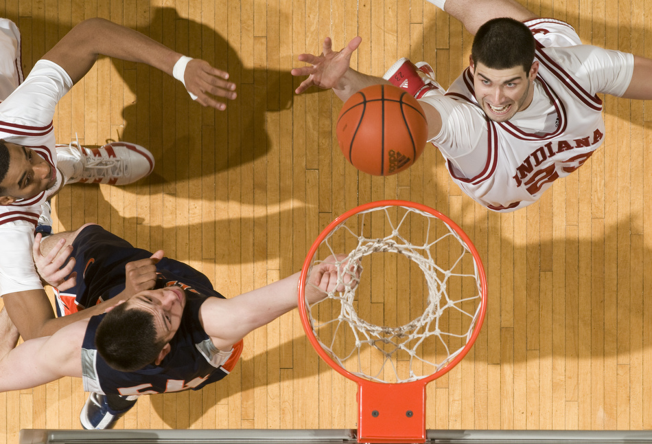 Indiana forward Bobby Capobianco, right, reaches out to grab a rebound in front of Illinois center Mike Tisdale during the second half of IU's 66-60 loss to Illinois on Saturday, Jan. 9, 2010, at Assembly Hall.