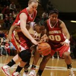 Indiana guard Jori Davis, middle, reacts after Wisconsin center Tara Steinbauer, left, and guard Jade Davis (00) strip the ball away during a game on Thursday, Jan. 28, 2010, at Assembly Hall.