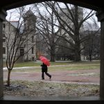A women walks through a sleeting winter storm on Friday, Feb. 5, 2010, in the Old Crescent portion of the IU campus. Above freezing temperatures turned an anticipated snow storm into rain and sleet for the early part of the day.